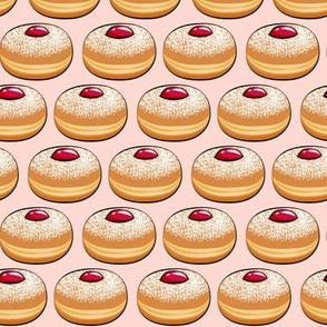 Sufganiyot (Jelly Doughnuts) on pink