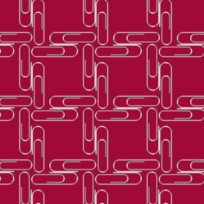 Paperclips on maroon