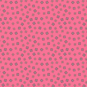 Small ditsy floral on a red pink background