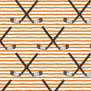 hockey sticks on stripes - orange C18BS