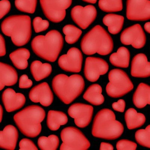 red pebble hearts on black