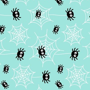 spiders and webs on light teal » halloween rotated