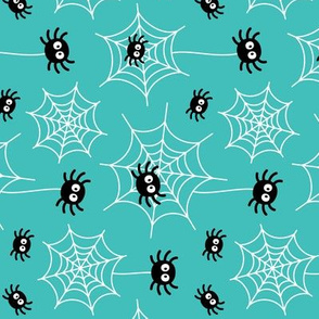 spiders and webs on teal » halloween rotated