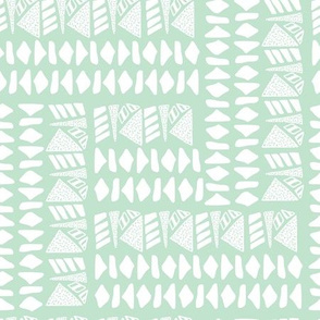 White textured geometric shapes on mint base
