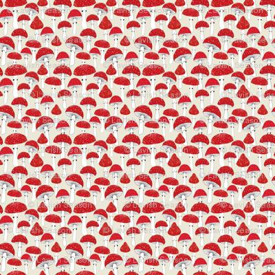 Red mushrooms on beige /scale/