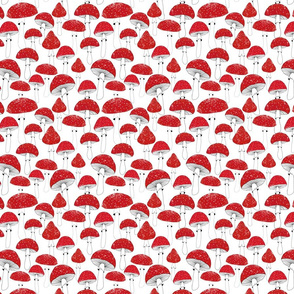 Red mushrooms on white /scale/