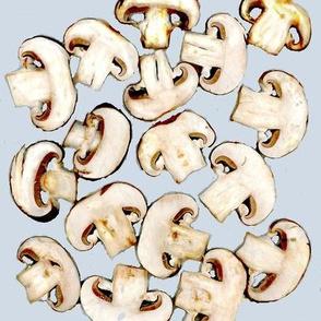 mushrooms chopped on pale blue
