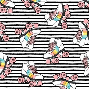 roller skates - pink wheels on black stripes