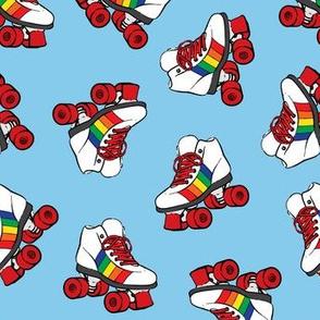 roller skates - rainbow on blue