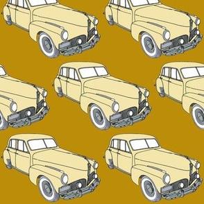 cream  1941 Studebaker sedan on golden background