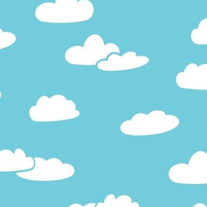 fluffy clouds on blue background