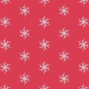 white lace snowflakes on red