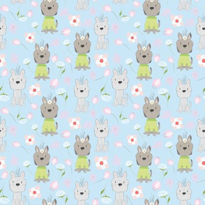 Adorable little puppies and flowers on  blue