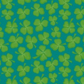 A tumble of green clovers on blue