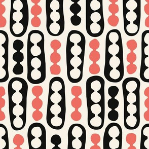 Pebbles and Pods in coral, black and cream