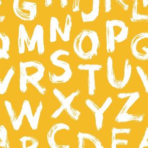 Alphabet letters ocre paint