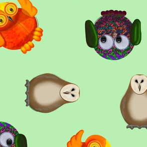 Toy owls on mint green