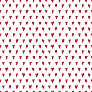 Little red hearts on white