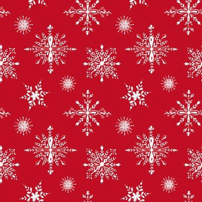 White snowflakes on holiday red
