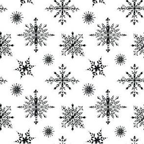 Elegant black snowflakes on white, holiday