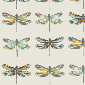 Aqua and yellow dragonflies on light beige