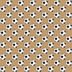 Half Inch Black and White Soccer Balls on Camel Brown