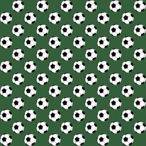 Half Inch Black and White Soccer Balls on Hunter Green