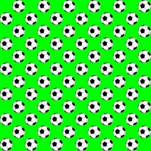 Half Inch Black and White Soccer Balls on Lime Green