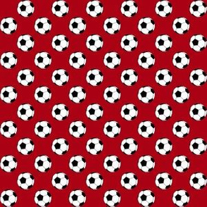 Half Inch Black and White Soccer Balls on Dark Red