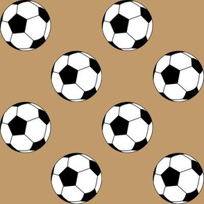 Two Inch Black and White Soccer Balls on Camel Brown