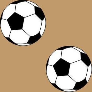 Three Inch Black and White Soccer Balls on Camel Brown