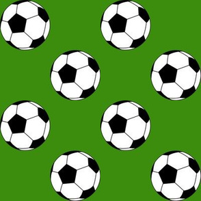 Two Inch Black and White Sports Soccer Balls on Apple Green