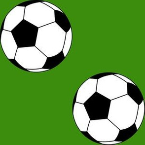 Three Inch Black and White Sports Soccer Balls on Apple Green