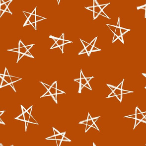 ditsy scribble stars on  Terracotta