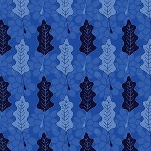 Blue oak leaves on textured background