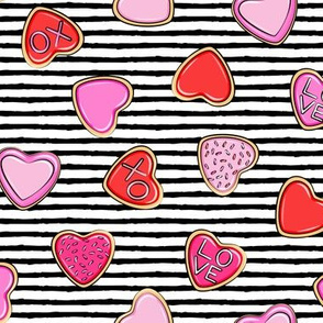 heart sugar cookies - valentines - pink and red on black stripe