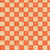 orange and tan checked pattern with snowflake inspired elements