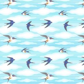barn swallows in flight