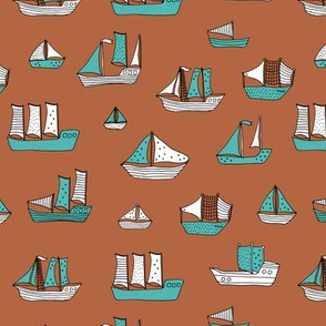 Fishing sailing boats and pirate ships on the shore and at sea copper blue boys winter