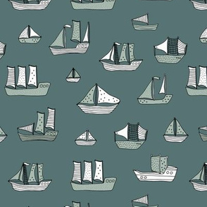 Fishing sailing boats and pirate ships on the shore and at sea dusty green winter