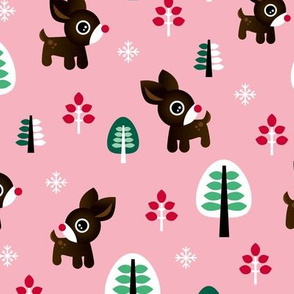 Christmas time reindeer winter wonderland with forest trees and snow flakes pink winter girls