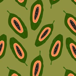 Papaya fruit on green leaf