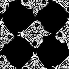 Linocut Butterflies on black background
