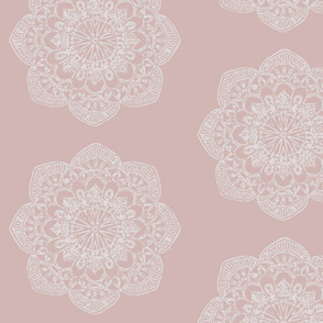 white medallion on blush pink