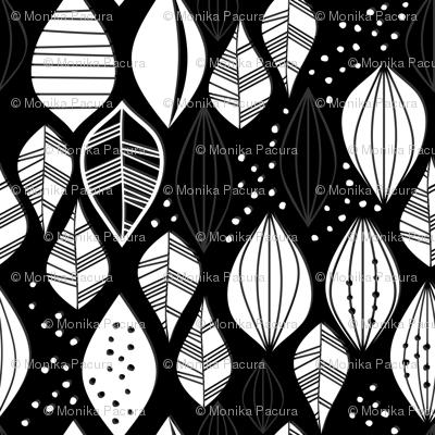 white vertical leaves on dark