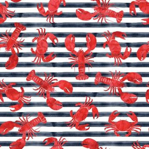 lobsters and crabs on navy stripes