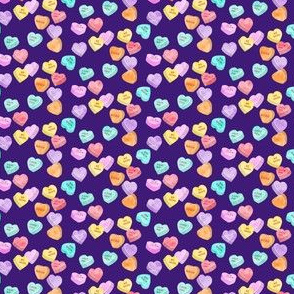 (micro scale) valentines day heart candy - conversation hearts on dark purple C18BS