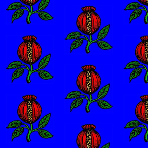 pomegranate slitted and leafed on blue