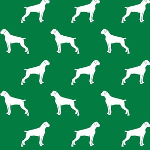 boxer dogs on green - docked tails
