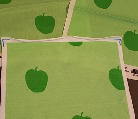 Green apples on green background